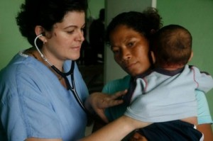 Dr. Beatriz E. Juncadella helping a child
